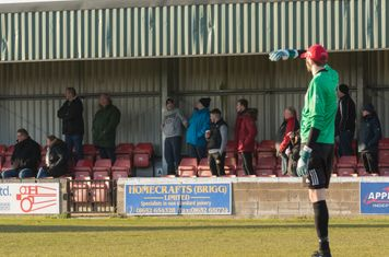 Spectators watching the match.