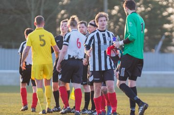 Players shaking hands at full time.