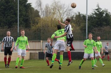 George Merrick winning a header.
