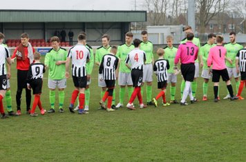 Players shaking hands before kick off.