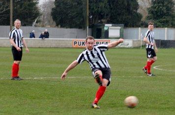 Liam Wright passing forwards.