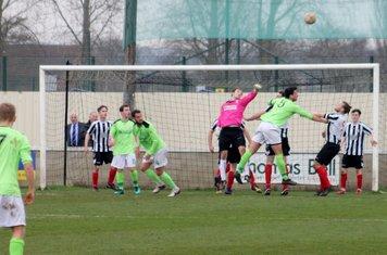 Paddy Shaw punching the ball.