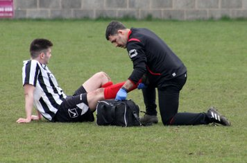 Terry Gowing treating Ben Brown.