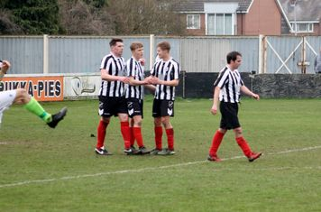 Myles Lawman being congratulated for scoring.