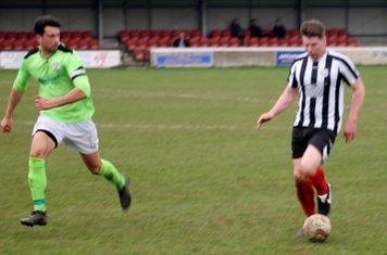 Cameron Hill dribbling forwards.