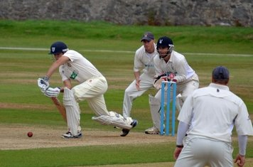 Graeme Tomlinson fending off the spin attack of Grange