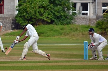 Harsha hitting back down the line