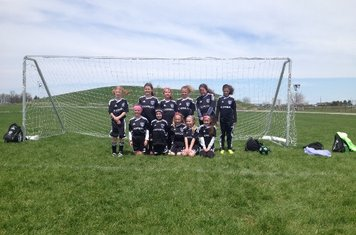 Express U9 Girls.  Bowling Green Soccer Challenge.  Despite the windy conditions the girls went 2 -1.  Great effort for their first out of State tournament!!!
