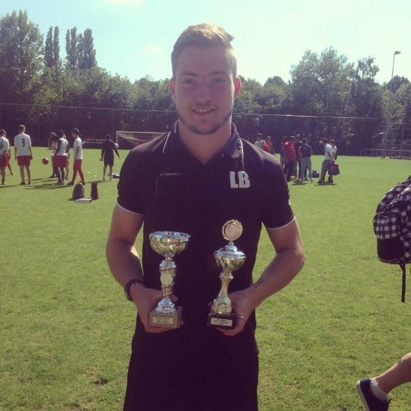 Manager - Lewis, with the two trophies won in Holland.