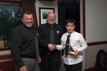 Most improved player Max Agnew receiving his award from Murray Duguid and Les Couparr.