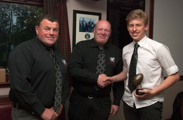 S1-2 Player of the Year Fraser Whyte receiving his award from Murray Duguid and Les Coupar