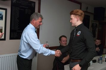 U18 player of the year Jack Wilson receiving his award from Colin Robertson