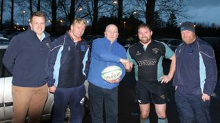 Match Day Sponsor Aidan Harrigan, Harrigan Fuels, presents a sponsorship ball to Head Coach Jimmy Carson along with L-R Club Vice-Chairman Alec Houston, Richard Beggs and Chris Cochrane following the 1st XV match with Queen's University on Saturday.