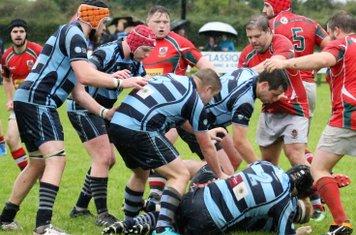 Ballymoney forwards halt a Larne attack