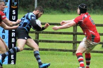 Centre Martin Irwin scores the last ballymoney try