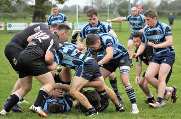 Ballymoney backs in charge at the ruck.