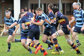 Ballymoney's Irwin, Strang and Watson stop a Banbridge attack.
