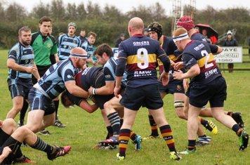 Captain, John McFetridge puts in a hard tackle on the Banbridge player.