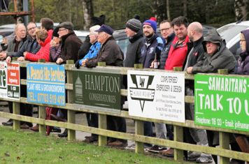 Spectators enjoying an excellent Cup match.