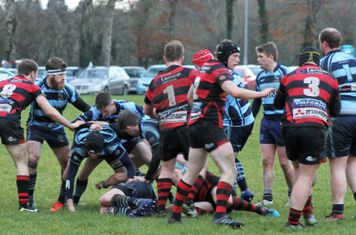 Ballymoney try to break the Armagh defence.