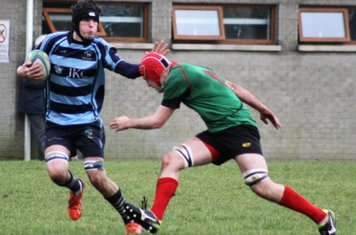 James Bleakley swats aside an attempted PSNI tackle.