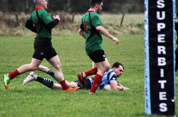 Rory dives to score.