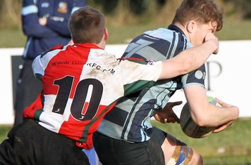 Davy receives attention from the  UUC flyhalf.