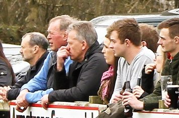 Heaney, Joe, Toss, Gary P and several others look on as Lisburn score.