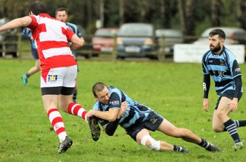 Jamesy tackles the Randalstown second row.
