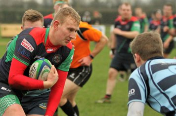 The Clogher outhalf prepares to take Matthew's tackle.