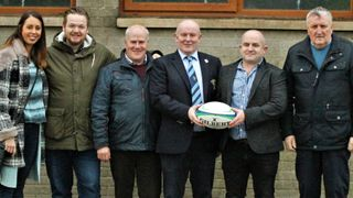 Ballymoney RFC Club President receiving the match day ball from Sponsors Causeway Geotech, prior to the Town's KQ2 League match with the University of Ulster, Coleraine RFC 1st XV