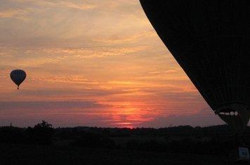 Balloons landing at sunset.