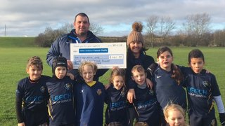 Under 9s present Helen Rollason with an almighty cheque!