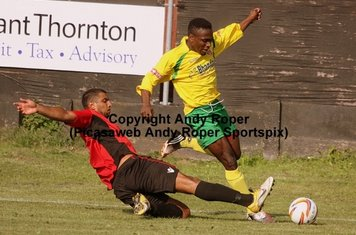 Roly Agbor evades a Redditch challenge on his way to goal.