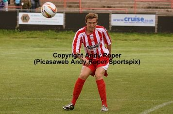 Aaron Drake clears the ball, setting up another Stourbridge attack.