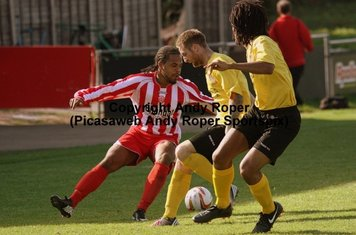 Luke cuts back, wrong footing the Chesham defenders.