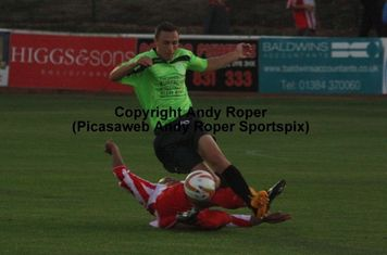 Luke Benbow slides in to retrieve the ball.