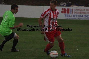 Ben with back to goal and Chippenham's James Guthrie.
