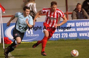 Will Richards takes possession of the ball from Poole striker Richard Gillespie.....