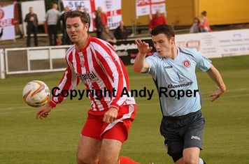 Nathan in control of the ball ahead of Town forward Richard Gillespie.....