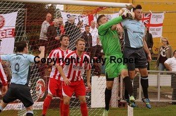 Dean makes the ball his ahead of Poole's Dan Cann