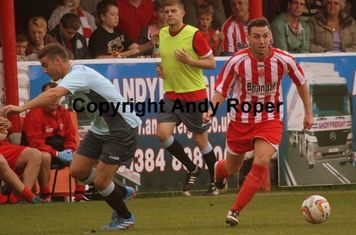 Drew sidesteps Poole defender Will Spetch.....