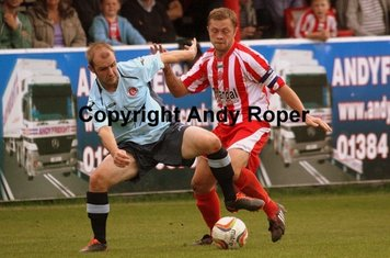 .....winning the battle with the Poole midfielder!