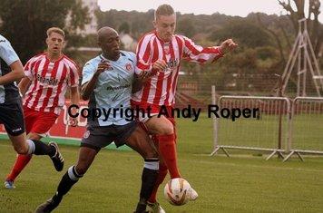 Jordan battles with Poole substitute Ekow Elliott.....