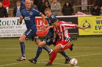Once again Ryan battles with Hunt, this time on the edge of the Curzon Ashton penalty area.....