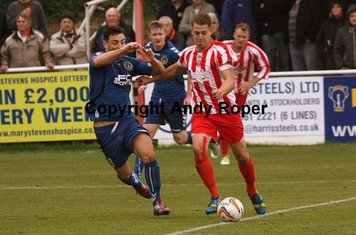 Ben tussles with Chris Young on the edge of the penalty area.....