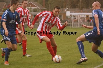Drew looks for space between substitute Nicholas Haughton and centre back Andrew Watson.....