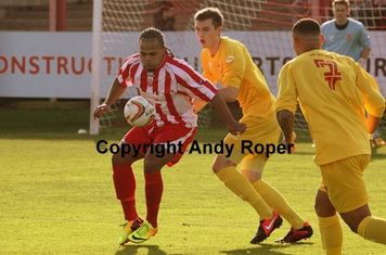 Luke receives the ball with his back to the Banbury goal.....