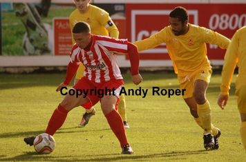 Ryan holds off Banbury centre half Wayne Blossom.