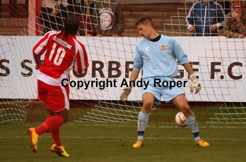 Luke puts the ball past Banbury 'keeper Leigh Bedwell.....